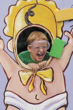 """Jack Bianco, 7, gets a face full of the wet stuff during the """"Sponge Baby"""" game."""