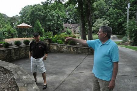 Huntcliff HOA Pres. Dane Seibert and his neighbor, Michael Fowler, discuss some of the neighborhood's interesting features.