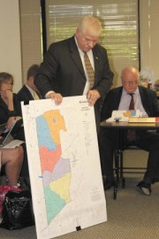 Brookhaven Police Chief Gary Yandura shows a map of the city's newly-created six police beats to members of City Council on June 11.
