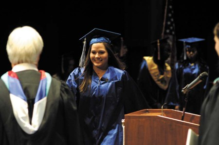 Mia Bomar, at right, receives her diploma from Principal Ron Tesch.