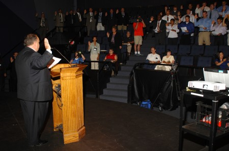 Brookhaven Mayor J. Max Davis swears in the city's new police officers on July 15 in a ceremony at The Marist School.