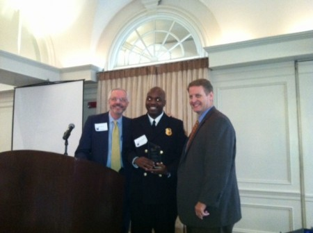 BBA board member Mark Shaver, left, presents Atlanta Firefighter Adolphus Henderson, center, with a Public Safety Award along with BBA President Brian Daughdrill, right.