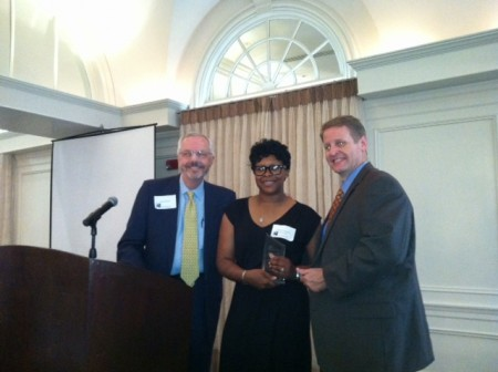 BBA board member Mark Shaver, left, presents Fulton County Sheriff's Deputy Yolanda Marshall, center, with a Public Safety Award along with BBA President Brian Daughdrill, right.