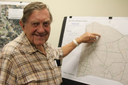 Charles Brake points out his home on the city of Dunwoody's sidewalk projects map during a public meeting Sept. 12 to review proposed new projects. A new sidewalk is planned for his street, Mount Vernon Way.