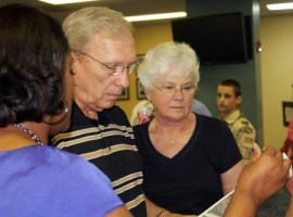 Charles and Sharlene Hamby talk to a transportation official about plans for replacing a bridge over Georgia 400.