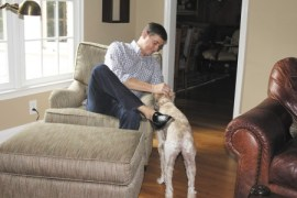 """Kerry de Vallette, with his dog """"Baer."""" De Vallette and his family returned to the area 20 years ago, when his job brought him back from Florida. They chose Dunwoody Club Forest since it was an established neighborhood with homes on large lots."""