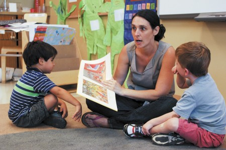 """From left, Nicholas Thompson, Madame Tiphaine Chauvel and Jacob Wolf go over a lesson in French  at the Atlanta International School's   Early Learning Center in Sandy Springs. Two years ago, the school began offering a """"full-immersion"""" preschool program for 3 and 4 year olds, with all activities taught in German, Spanish or French. Phil Mosier"""