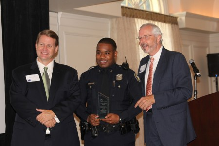 BBA President Brian Daughdrill, left, presents an award to Atlanta Police Officer Terrence Epps, center, along with BBA Vice President of Public Safety Mark Shaver, right.