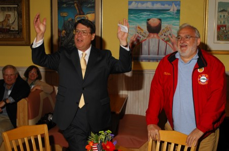 In Sandy Springs, Mayor-elect Rusty Paul, left, thanks the crowd at his victory party at J. Christophers Nov. 5 as re-elected City Councilman Tibby DeJulio looks on.