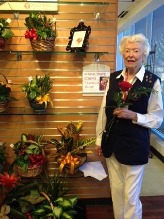 Marguerite Oberg in the flower shop named for her.