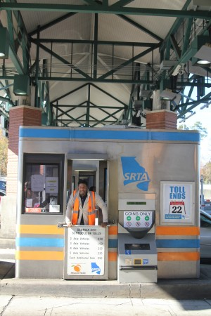 Kaz Jones checks out one of the toll collection booths at the Ga. 400 Toll Plaza, where he worked as a cashier.
