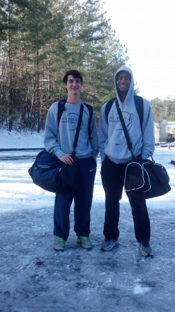 "St. Pius students Joey Carbonara of Roswell and Chandler Parks of Sandy Springs walked up Spalding Drive on Jan. 29 to catch a ride home after spending the night with a friend. """"We were getting picked up by our friend''s mom yesterday after school because we got let out early. We came home on Spalding and she didn't want to drive us all the way back up this hill because she was afraid her car wouldn't make it, so we just stopped at their house and spent the night there,"""" said Carbonara. """"We''ve been inside the whole time, sitting around, playing video games."" """"We went outside yesterday and the whole road was ice and we just went around and ran on it. It was fun,"""" said Parks. """"We''re meeting my dad up the hill."" Photo by Elizabeth Wilkes"
