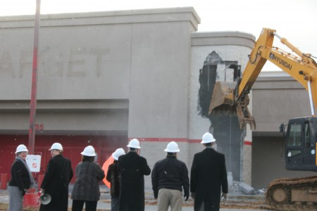 Sandy Springs Mayor Eva Galambos, City Manager John McDonough and members of the city council watch as the facade of the old Target building on Johnson Ferry Road falls.