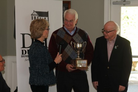 Su Ellis of the Dunwoody Nature Center, left, presents the center's Dave Adams Award to Rick Woods, center, and Harvey Rosenzweig of the Rotary Club of Dunwoody during the Dunwoody Homeowners Association's annual meeting Jan. 12 at the Kingsley Racquet and Swim Club.