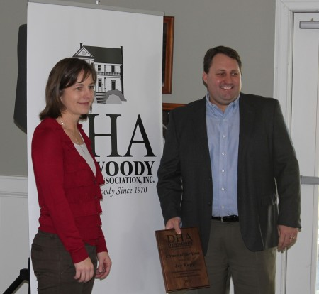 Dunwoody Homeowners Association president Stacey Harris, left, presents Jay Kapp with the DHA's Citizen of the Year Award during the DHA's annual meeting Jan. 12 2014 at Kingsley Racquet & Swim Club.