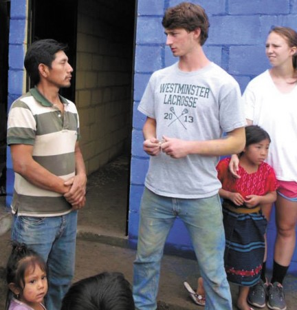 Collins Speed, center, raised $800 by selling tools he manufactured through his metalcrafting skills, in order to visit Guatemala.