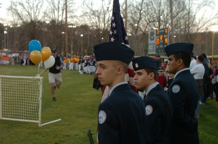 Dunwoody High School ROTC color guard -- left to right, Cadet Senior Airman Scheff, Cadet Capt. Botsch and Cadet Airman Kharel -- present the colors during the Opening Day ceremonies at Murphey Candler Park on March 7.