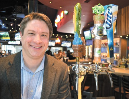 Lynn Davis, founder and publisher of The Beer Connoisseur magazine, with the taps at Taco Mac in Sandy Springs.