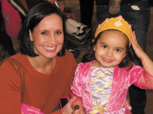 Dr. Lisa Lefkovits and daughter Vivian celebrate Purim at the Marcus Jewish Community Center in Dunwoody.