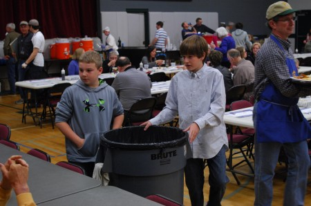 Keegan LeBoeuf, left, and Mick Gulledge take on clean-up duty during the All Saints Catholic Church fish fry on March 14.