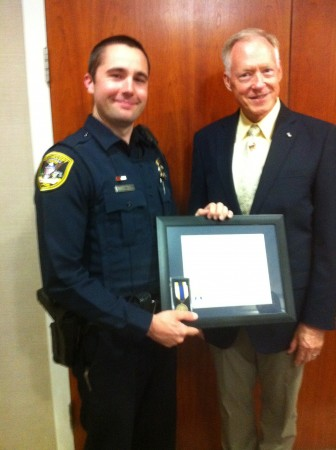 Dunwoody police officer Danny Tedesco, left, was honored by the Sons of the American Revolution for providing life-saving care to Larry Guzy.