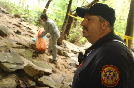 """CATS"" member Francisco Escovar, a sophomore at Cross Keys picks up as firefighter Pete Erickson, a member of DeKalb Fire Station Number Two on Dresden in Brookhaven watches. DeKalb firefighters were on hand to make sure everyone was safe, and out of the water."