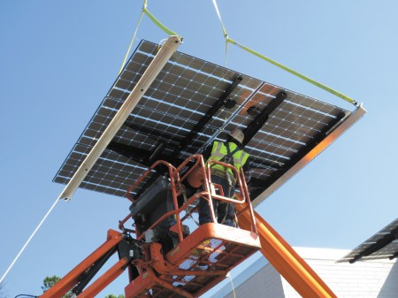 Workers install the solar tree outside Hannah Solar's offices on Collier Road in Buckhead. The tree will be used to charge electric vehicles. Courtesy Hannah Solar
