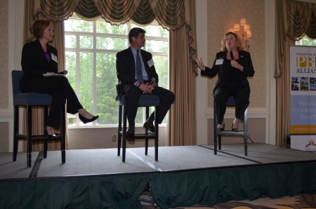 Perimeter hotelier Tracy Kaltman-Ahmed, at left with mic, talks to members of the Perimeter Business Alliance on April 25. Fellow panelists  Shelly Faraj, left,Peter J. Dunn, center, listen.