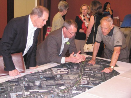 Buckhead Community Improvment District executive director Jim Durrett, center, reviews plans for a new Peachtree streetscape with Jim Stokes, left, and Jim Morgens, right.They were reviewing the plans during a public meeting April 3 at Peachtree Road United Methodist Church.