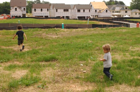 Homes being built as part of the Renaissance Project rise along the edge of the park.  Memphis Morales, 5, and his brother Greyson, 2, explored the area on May 17, the day the park opened.