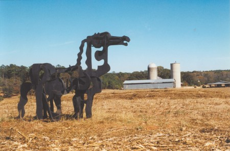 This metal horse, defaced by UGA students in the 1950s, stands in a field near Greensboro.