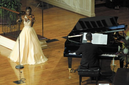 Asia Charles plays the violin.