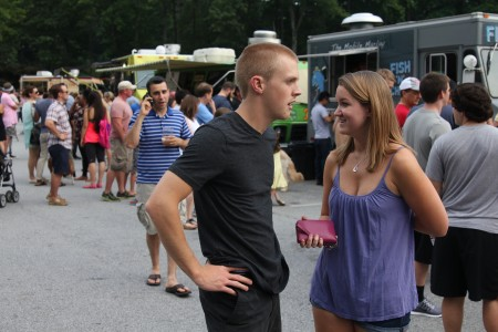 Kristen DeVos of Dunwoody and Jacob Clawson of Jacksonville, Fa., check the offerings of the food trucks gathered at Brook Run Park for Food Truck Thursday on June 19.
