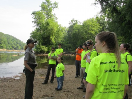 Allyson Reed (left) with the Chattahoochee River National Recreation Area teaches KSU students about the history of the river.