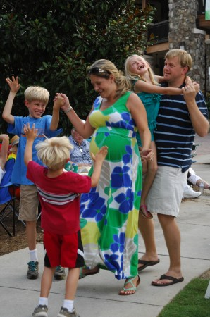 """While the Athens-based band """"Grains of Sand"""" played at the July 13 Concert by the Springs sponsored by Heritage Sandy Springs, members of the Kelly family -- Mike and Jamie Kelly and sons Patrick, 9, and Charlie, 5, and daughter Emily, 7 -- joined together for an exuberant family dance.."""