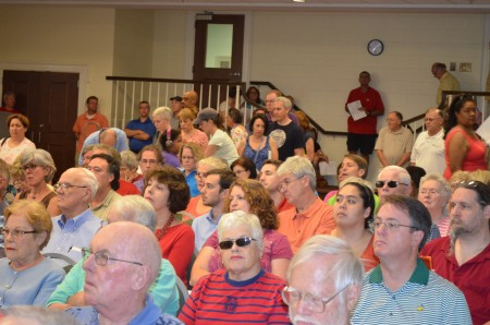 The standing-room-only crowd filled the fellowship hall at Chamblee First United Methodist Church on July 1 to talk about tax appeals.