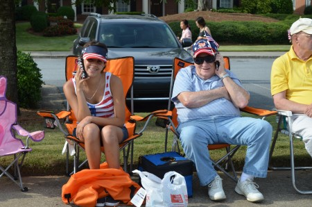 Maria Rodriguez, 13, and her grandfather, Howard Kornfield, wait for the start of the Dunwoody Homeowners Association's July 4 parade.