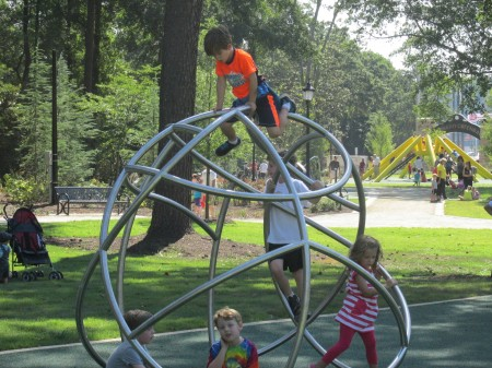 Children enjoy the playable art at the Abernathy Greenway.