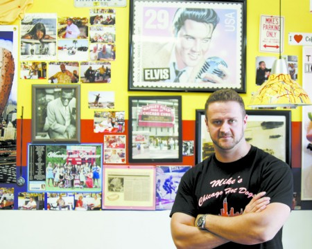 Mike's Hot Dogs owner Elvis Hajdarevic in the Sandy Springs restaurant that has offered a little bit of Chicago on a bun and on its walls since 1996.