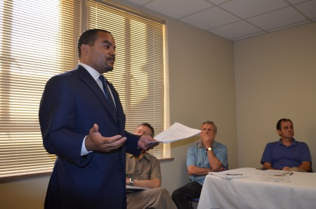 Lawyer Hakim Hilliard outlines for members of NPU-B's zoning committee the objections of residents to a plan to build a rectory for six priests on West Wesley Drive.
