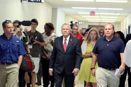 Gov. Nathan Deal tours the new facilities at Chamblee Charter High School Aug. 13 among student leaders and press.