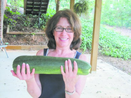 """Robin shows off her 16"""" x 4"""" home grown zucchini."""