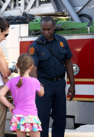 Madeline Vicine, 7, of Dunwoody shakes hands with firefighter Karsten Green of the Dekalb County Fire Department