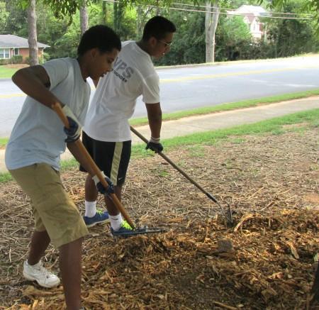 Mount Vernon 11th-graders Epi Yonas (left) and Jacob Munoz do a little raking.