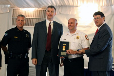 L to R: Police Chief Ken DeSimone, City Manager John McDonough, Fire Officer of the Year Capt. Chris Edmondson, Mayor Rusty Paul.