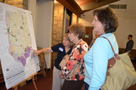 At left, Joan Callahan, Susan Houston and Sarah Edwards, left to right, review a draft of a proposed map for a new plan for the North Buckhead neighborhood.