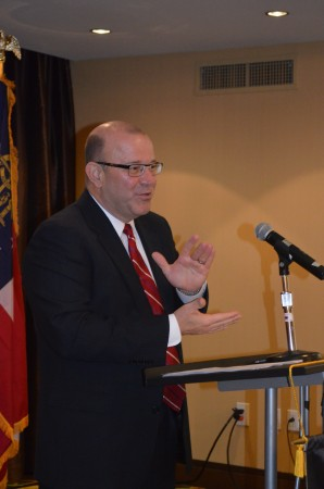 Michael Tipsord, vice chairman and chief operating officer of State Farm, speaks to the Dunwoody Chamber of Commerce on Oct. 30, 2014.