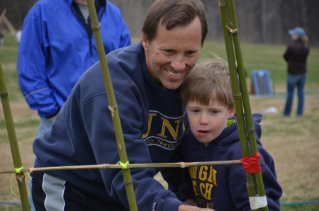 Zach Holcomb and his son Alex participate in a challenge.