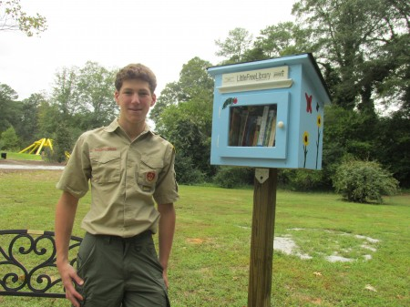Bryan Weselman built and installed a little library at the Abernathy Greenway entrance. The unit was his Eagle Scout project.