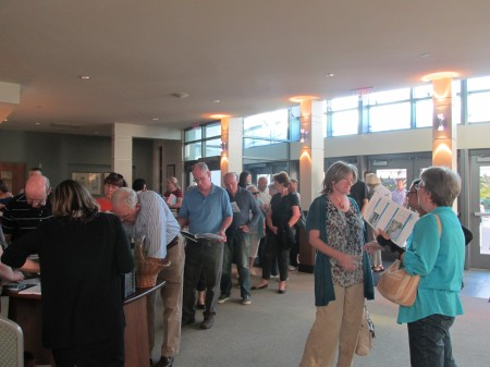 Residents line up to view plans.
